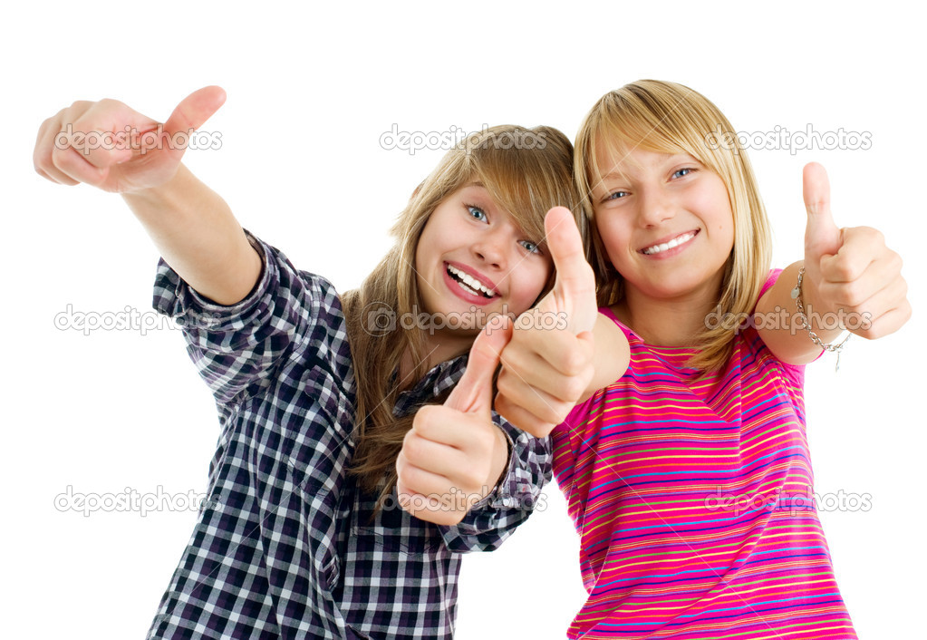 Portrait of happy teen girls showing thumbs up isolated one white  Stock Photo #10676020