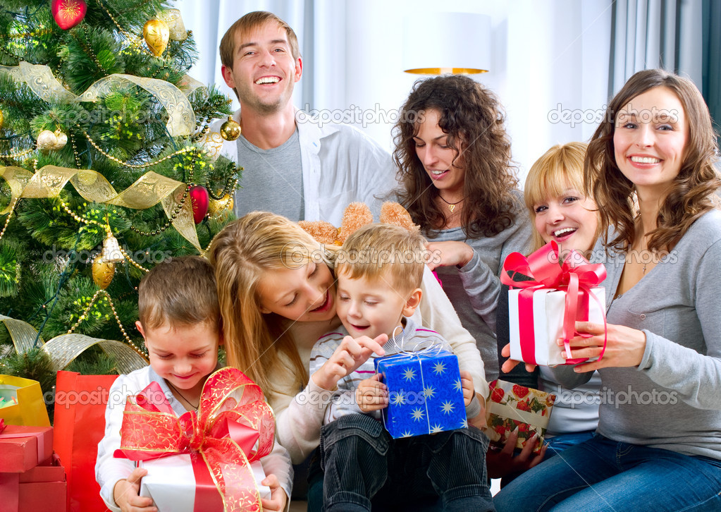 Happy Big family holding Christmas presents at home.Christmas tree — Stock Photo #10676215