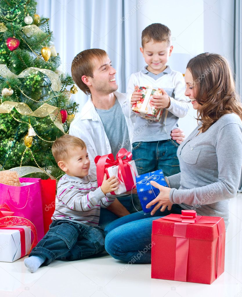 Happy Big family holding Christmas presents at home.Christmas tree — 图库照片 #10676228