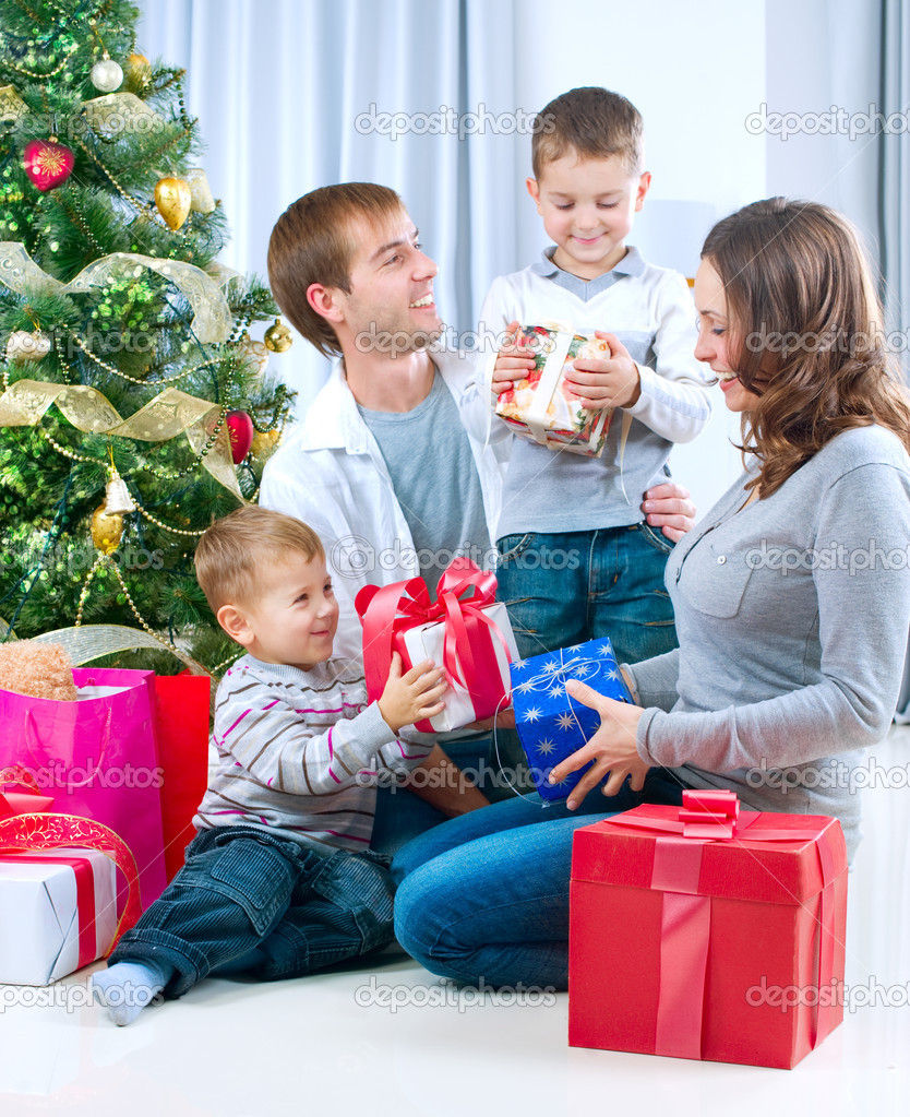 Happy Big family holding Christmas presents at home.Christmas tree — Foto Stock #10676228