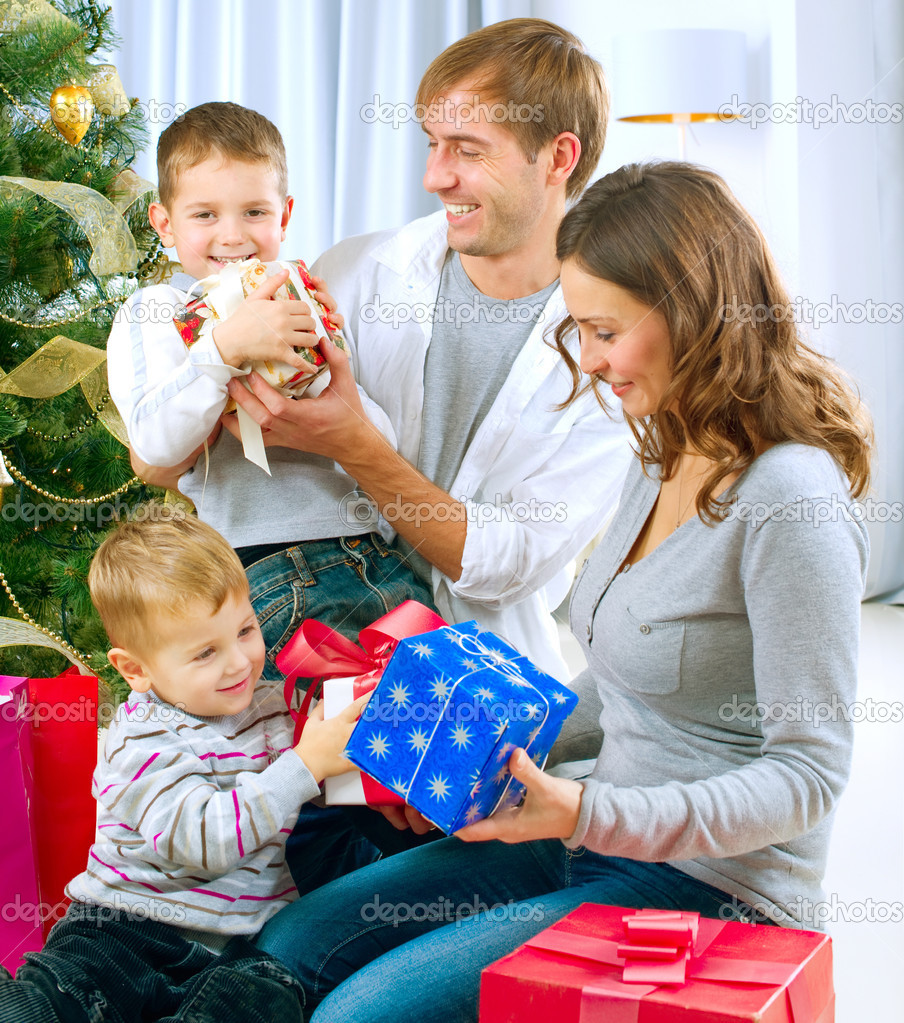 Christmas Family with Gifts — Stock Photo #10676242