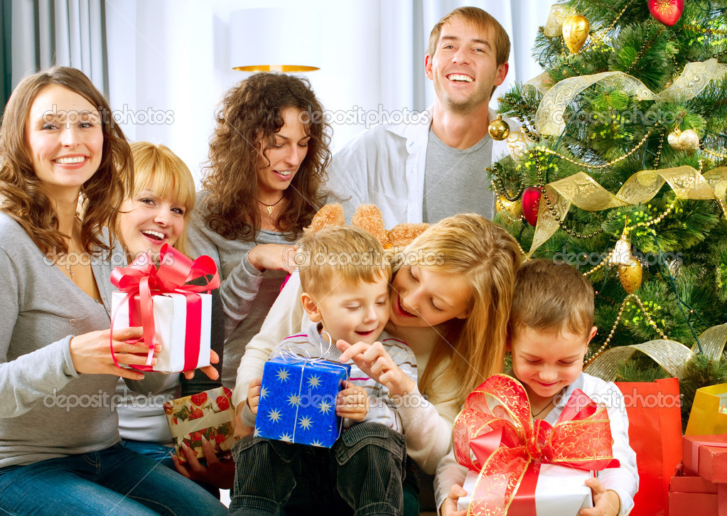 Happy Big family holding Christmas presents at home.Christmas tree — Stockfoto #10676261