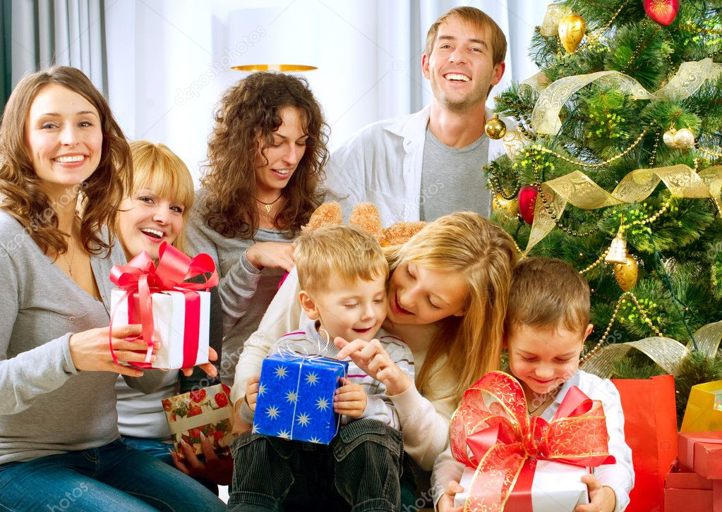 Happy Big family holding Christmas presents at home.Christmas tree — Стоковая фотография #10676261