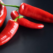 Red Hot Chili Peppers Over Black — Stock Photo