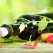 Stock Photo: Bottle Of Red Wine And Grape Leaves
