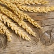 Wheat Ears on the Wood . Food Background — Stock Photo #10680880