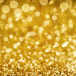 Stock Photo: Christmas Golden Glittering background.Holiday Gold abstract tex
