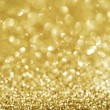 Christmas Golden Glittering background.Holiday Gold abstract tex — Stock fotografie #10681337