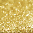 Christmas Golden Glittering background.Holiday Gold abstract tex - Stock Photo