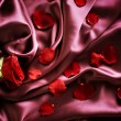 Royalty-Free Stock Photo: Red Silk And Rose Petals