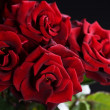 Beautiful Red Roses Bouquet over black - Stock Photo