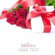 Valentine gift box and red roses bouquet — Stock Photo