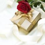 Wedding or Valentine gift over white silk — Stock Photo