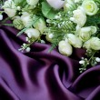 Bridal Bouquet over silk background — Stock Photo
