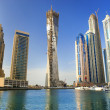DUBAI, UAE - NOVEMBER 29: View at modern skyscrapers in Dubai Ma - Stock Photo