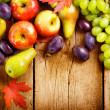 Organic Fruits over wood background. Autumn harvest — Stock Photo