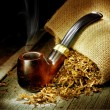 Wooden Pipe And Tobacco Design. Over Black Background - Stock Photo