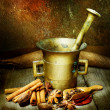 Spices And Antique Mortar With Pestle - Stock Photo
