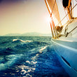 yacht sailing against sunset.sailboat.sepia toned — Stock Photo