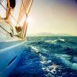 Stock Photo: Yacht Sailing against sunset.Sailboat.Sepitoned