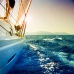 Yacht Sailing against sunset.Sailboat.Sepia toned — Stock Photo