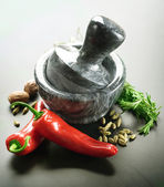 Mortar With Pestle And Herbs. Over Black Background — Stock Photo