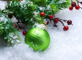 Christmas Bauble over Snow background — Stock Photo