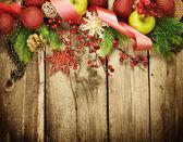 Weihnachten vintage dekoration grenze zu entwerfen, gegenüber dem alten holz-hintergrund — Stockfoto