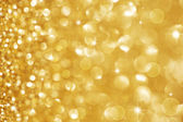 Christmas Golden Glittering background.Holiday Gold abstract tex — Stok fotoğraf