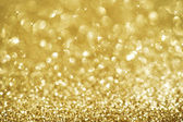 Christmas Golden Glittering background.Holiday Gold abstract tex — Stock fotografie