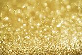 Vánoční zlaté třpytivé background.holiday zlata abstraktní tex — Stock fotografie