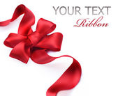 Red satin gift bow. Ribbon. Isolated on white — Zdjęcie stockowe