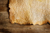 Old Paper Sheet Over Wooden Background. Closeup — Stock Photo