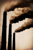 Three Smoke Stacks Polluting the Air Horizontal. Vintage Styled — Stock Photo