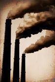 Three Smoke Stacks Polluting the Air Horizontal. Vintage Styled — Stock Photo