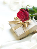 Wedding or Valentine gift over white silk — Stock Photo