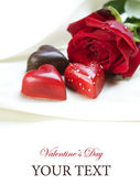 Valentine card. Chocolate hearts and red rose — Stockfoto