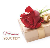 Valentine Gift and red rose over white — Stock Photo