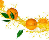 Orange fruits and splashing Juice in motion — Stock fotografie