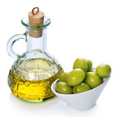 Extra Virgin Olive Oil and Green Olives over white — Stock Photo