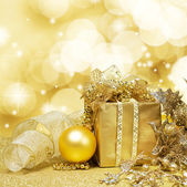 Christmas Decoration over Glittering Golden Background — Stock Photo