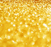 Christmas Glittering background.Holiday Gold abstract texture.Bo — Zdjęcie stockowe