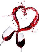Dwie szklanki czerwonego wina rozchlapać serce streszczenie — Zdjęcie stockowe
