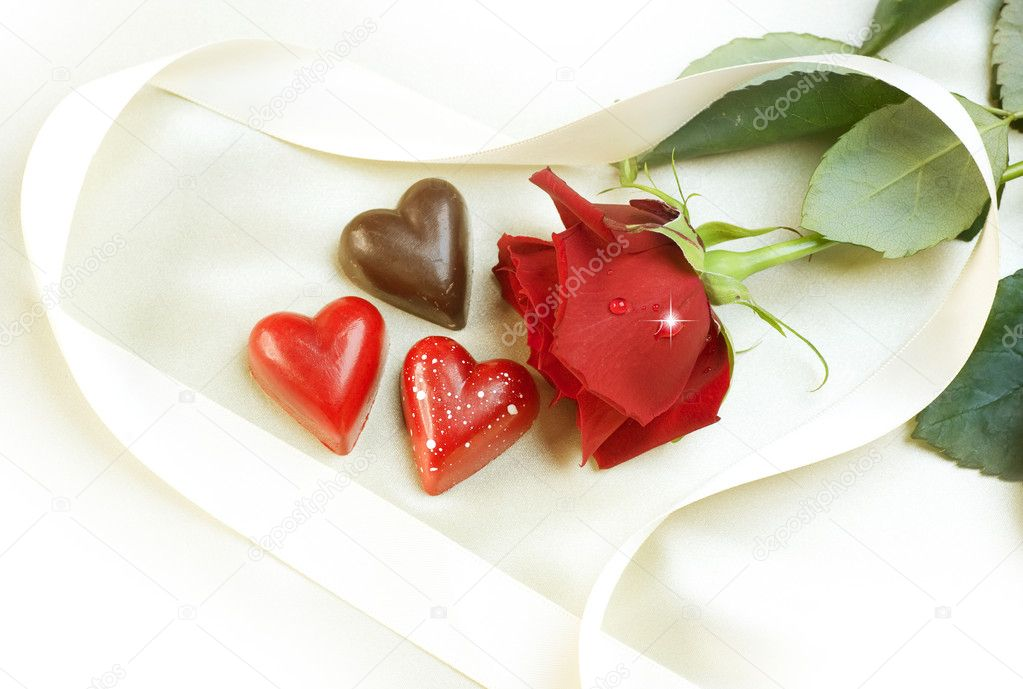 Valentine card. Chocolate hearts and red rose — Stock Photo #10685646
