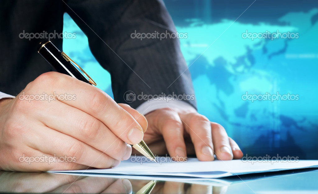 Businessman&#039;s hand with a pen. International business concept  Stock Photo #10686733