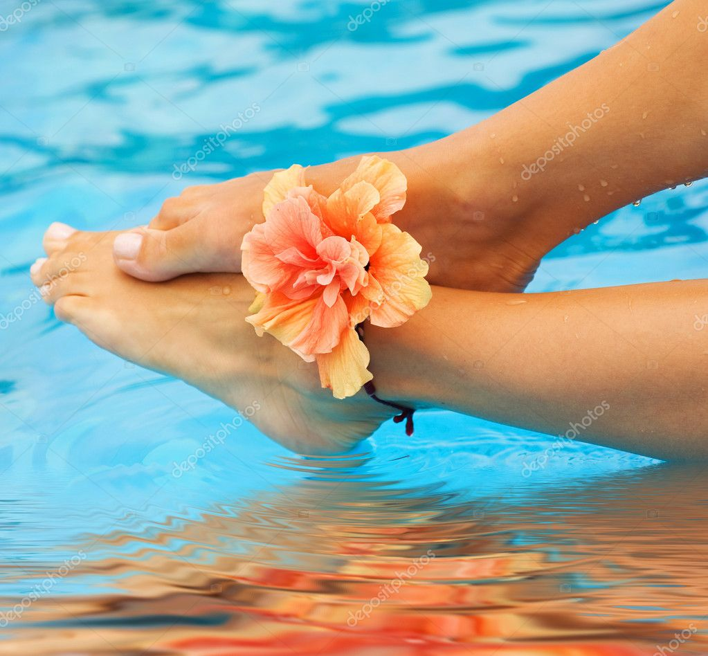 Vacation Concept. Legs In The Swimming Pool  Stock Photo #10687903