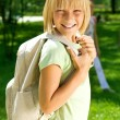 Foto Stock: Happy Schoolgirl Outdoor. Back To School