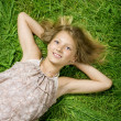 Cute Happy Girl Lying On A Green Grass - Stock Photo