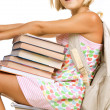 Education Concept. School Girl Sitting On The Stack Of Books — Stock Photo