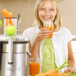 Happy Girl drinking fresh carrot and apple juice. Juice Extracto — Stock Photo
